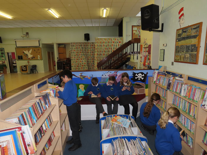 Children reading in the library